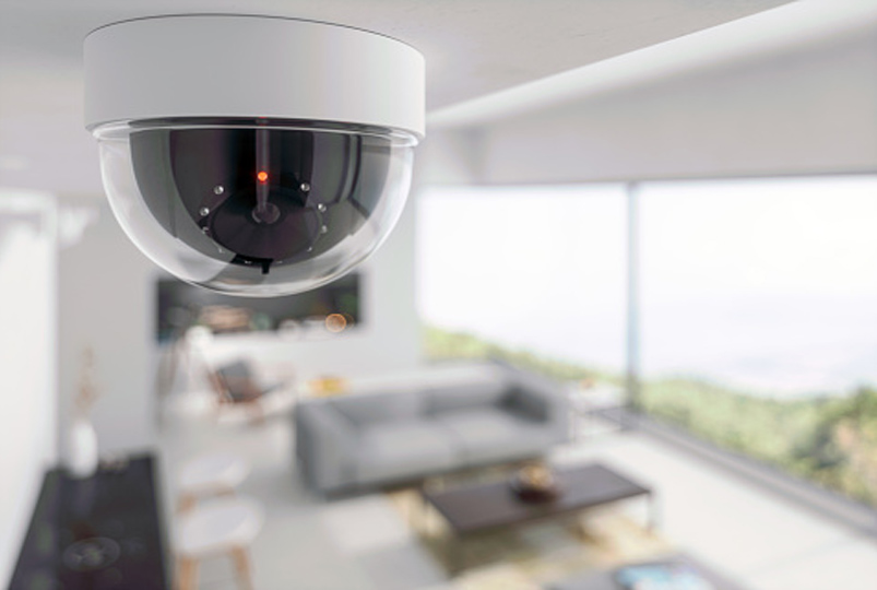 Ceiling security camera overlooking a room
