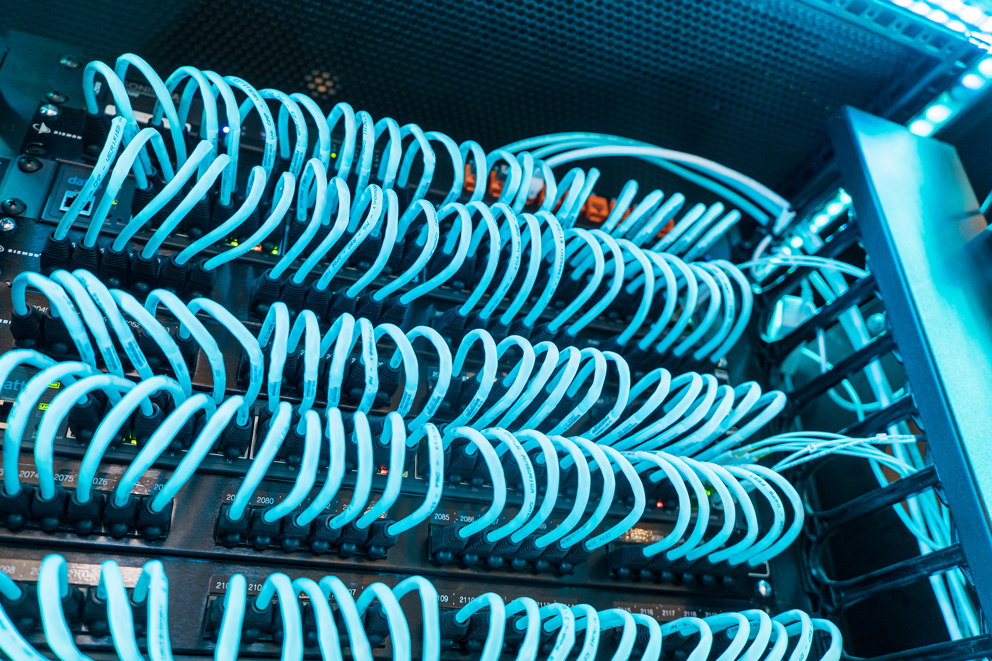 Blue, glowing cables plugged into hardware