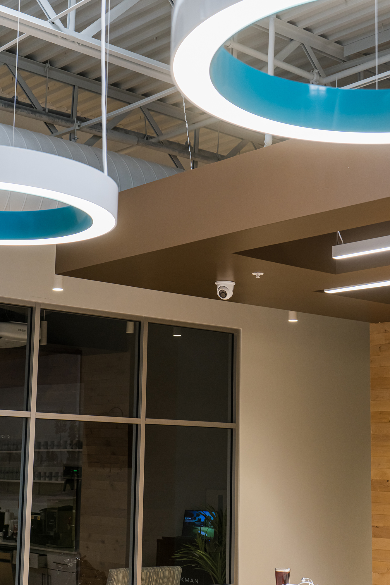 Large, round light hanging from a white ceiling
