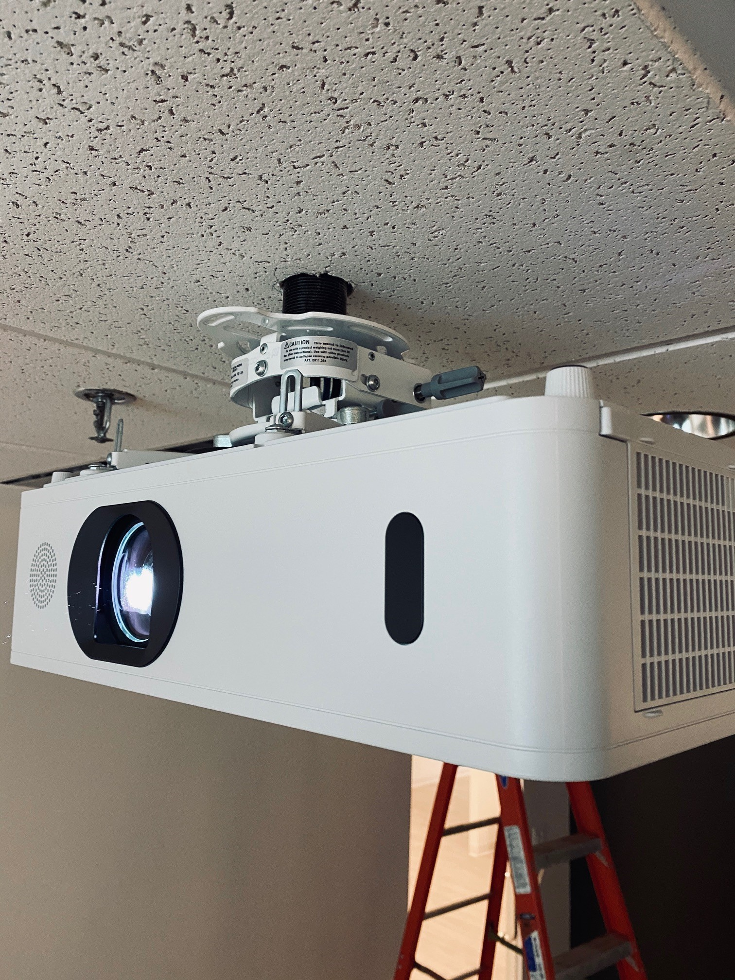 White projector on ceiling