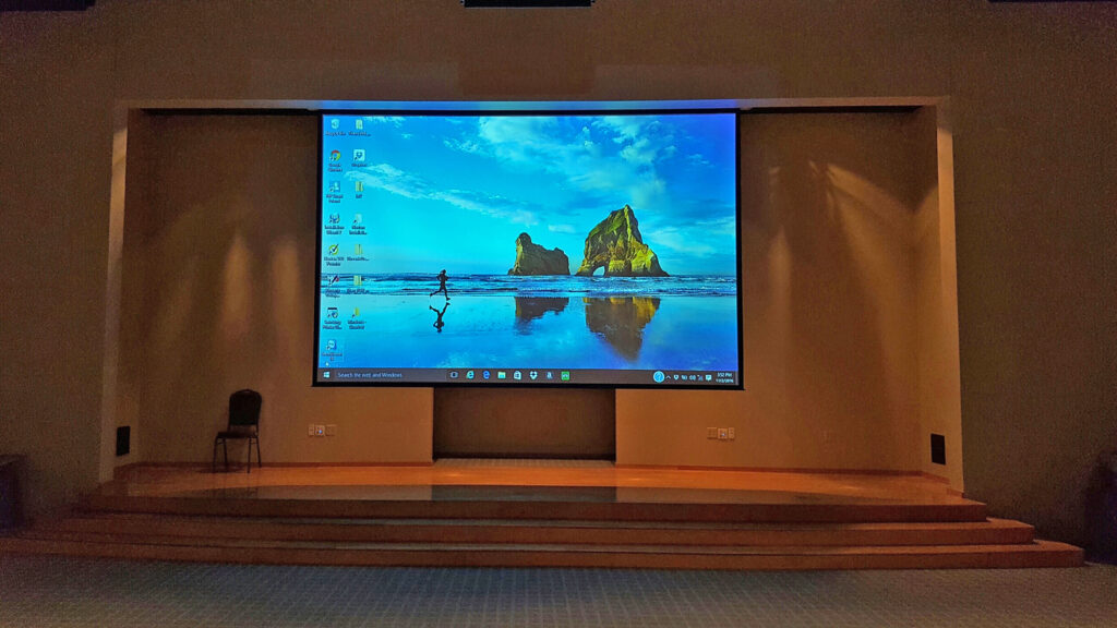 Desktop projected onto a projector screen in a meeting space