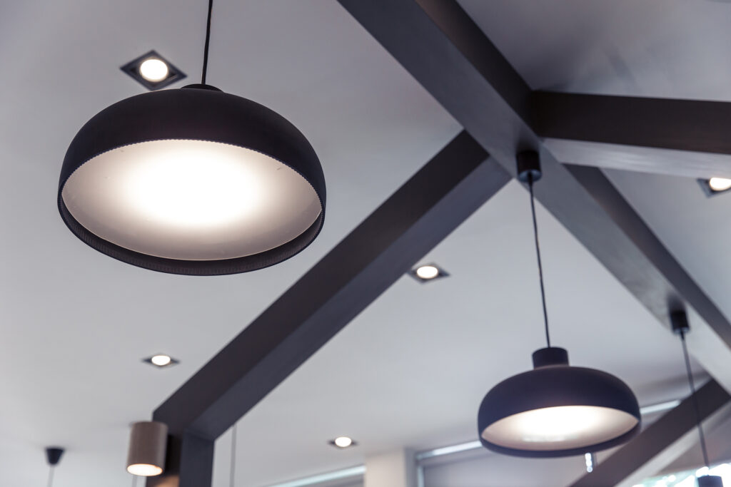 Drop lights hanging from ceiling of modern-style home
