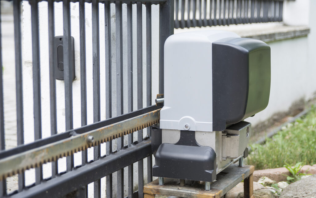 Close-up of motor to open an outdoor gate
