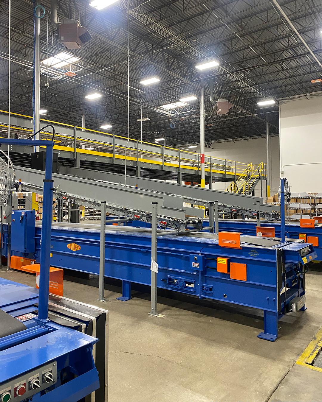 The end of a long, blue conveyer belt