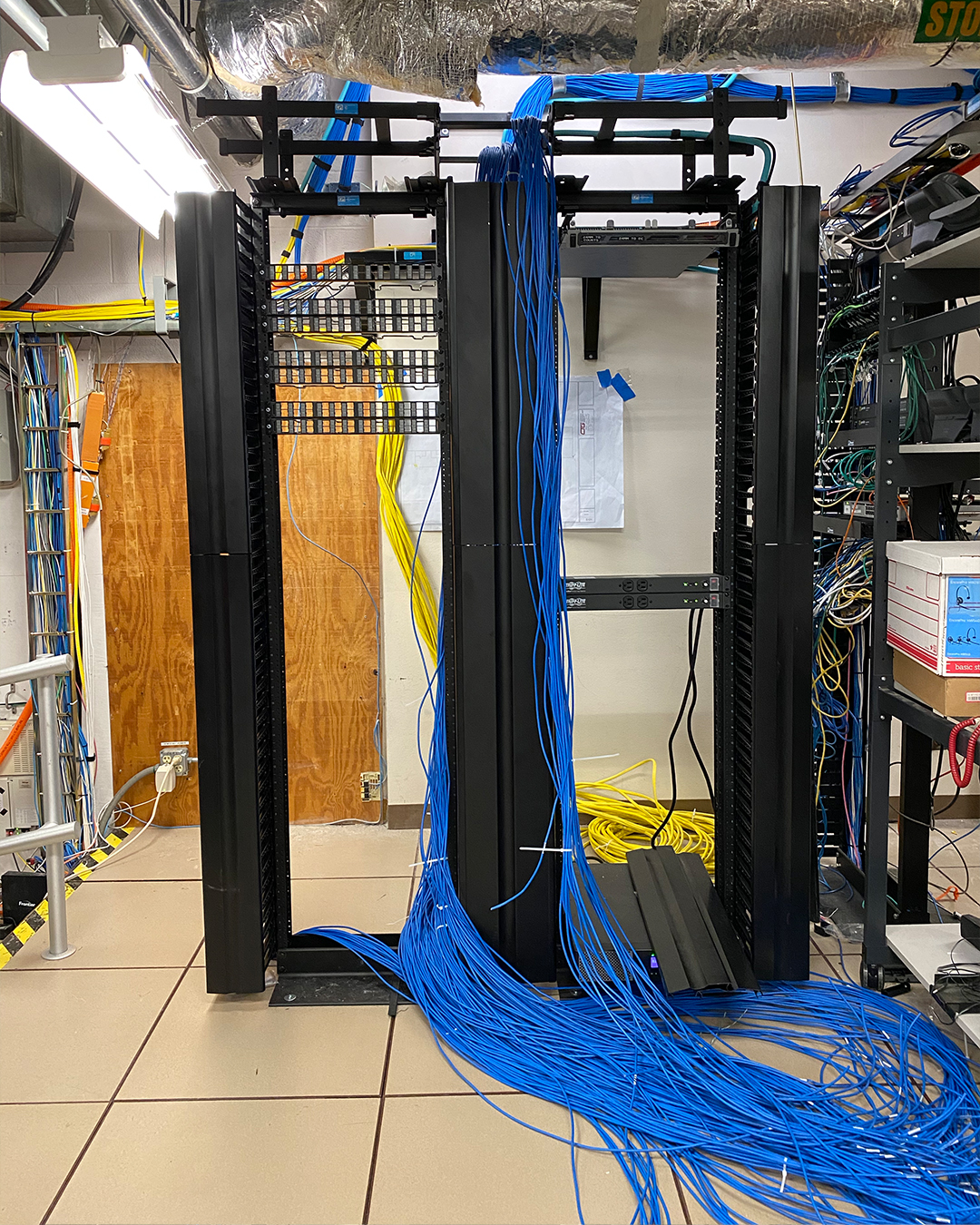 Long, blue cables coming out of the ceiling and draping onto the ground